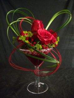 Red Freedoms, Red Hypericum, Bupleurum, Lily Grass & Red Midollino sticks.  martini glass design