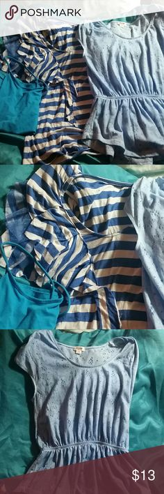 Lot of shirts 3 blue shirts  1 is white with blue stripes  one Is blue with dots and really light flower details   one a blue tank top.  All never worn.   From different brands. Target Tops