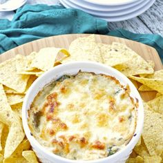 Caramelized Onion and Spinach Dip Recipe Appetizers with olive oil, butter, onions, sugar, garlic, baby spinach, kosher salt, freshly ground black pepper, reduced fat cream cheese, sour cream, garlic powder, cayenne pepper, jack cheese