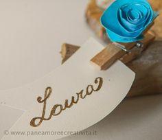 Matrimonio fai da te: il segnaposto con legni del mare e rose