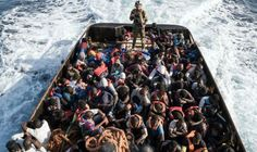"""Migrant crisis - Germany and France pledge to take more asylum seekers from Italy 