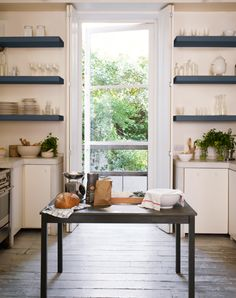 I love the table/island and how it is positioned in front of the doors. And the floor.