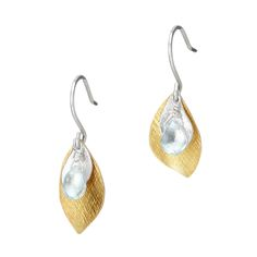 This gleaming pair of earrings adds a subtle splash of sea-inspired whimsy to your ensemble.
