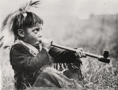Blackfeet boy learns to smoke peace pipe.