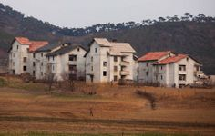 In this April 17, 2011 photo, a man walks near a stand of rural housing outside of Kaesong, North Korea.