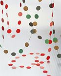 Plain white self-adhesive dots can be transformed into cheerful garlands. Working in a well-ventilated area, color the dots with wide felt-tip markers. Stick them, back to back, onto button thread, which is both silky and sturdy. Space stickers evenly, about 2 inches apart.