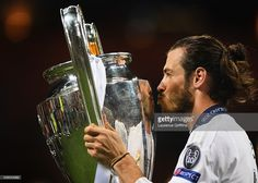 Gareth Bale of Real Madrid celebrates with the trophy after victory in the UEFA Champions League Final match between Real Madrid and Club Atletico de Madrid at Stadio Giuseppe Meazza on May 28, 2016 in Milan, Italy.