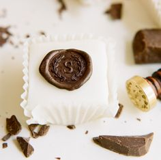 All you need is a little chocolate and a wax seal stamp! Simple and easy way to give you sweets a personalized touch.