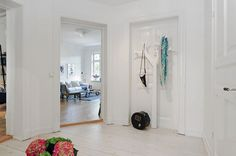 Apartments:Unique Hanger With A Tree Model In The White Wall Also Combined With White Wooden Floor And A Opened Door Apartment with 19th Cen...