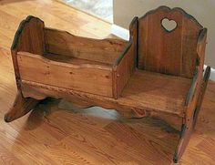 Child's Wooden Rocker Bench with Doll Bed.