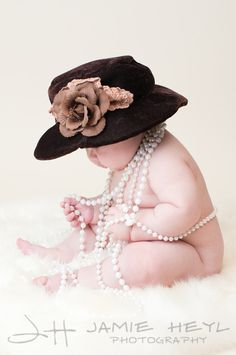 not a big fan of the old lady hat but the pearls and the chubby rolls are so cute!