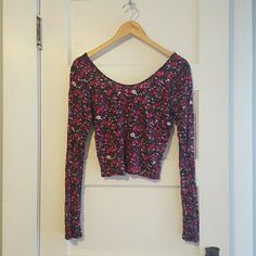 Floral Crop Top Soft cotton stretchy long sleeve crop top with multi colored flowers scattered all over it. Black base with pink, red, orange and white details. Comes about mid stomach. Aeropostale Tops Crop Tops