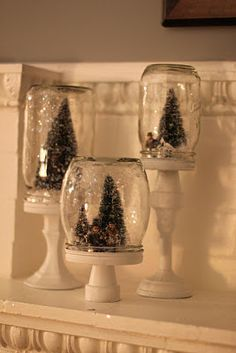 DIY-Mason jar Christmas display. Paint the inside of the jar with white glitter mod podge glue scene to lid. Glue jar to candlestick. Sooo cute!