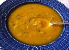 Squash and White Bean Soup 1 small onion, peeled and chopped 2 teaspoons olive oil 2 cloves garlic, chopped 4 cups water or vegetable stock 1 butternut, kabucha, or hubbard squash, peeled and cut into cubes (about 7 cups) 1 tablespoon minced fresh ginger or 1/2 teaspoon powdered ginger 1 teaspoon ground cinnamon 1/4 teaspoon ground nutmeg 1 1/2 tablespoons miso 1 tablespoon tahini 2 cups cooked white beans 1/2 cup minced fresh parsley or watercress Sea salt and black pepper to taste