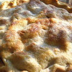 New Favorite Apple Pie Recipe Desserts with pie crust, baking apples, apple juice, corn starch, white sugar, brown sugar, cinnamon, ground nutmeg, clove, salt, lemon juice, butter