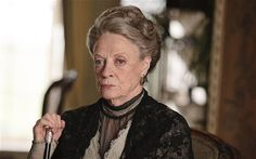"""Dame Maggie Smith has no plans to retire from Downton  Dame Maggie Smith has discussed her career and her grief for her late husband in a rare interview with American show 60 minutes. She said: """"I feel I won't work in the theatre again. I'm sad about that. But I won't retire, I'll keep going with Violet and any other old biddy that comes along."""""""