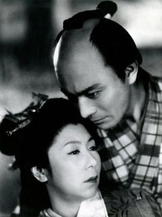 "The Life of Oharu 1952.  A publicity photograph, with the following information typed on the reverse: ""Kinuyo Tanaka and Toshiro Mifune in the late Kenji Mizoguchi's 'Life of Oharu', having its Boston theatrical premiere at the Brattle Theatre during the week of Nov. 3-9."" (Stamped Nov. 1, 1968)  ""Saikaku Ichidai Onna"" (The Life of Oharu- Kinuyo Tanaka-) is a motion picture by renowned Japanese Director, Kenji Mizoguchi, first released in 1952.' S)"