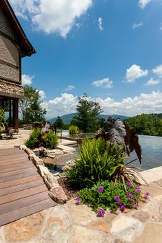 HGTV presents a stunning mountain retreat in Western North Carolina with a rock patio and small bridge that leads to the infinity pool. Living Pool, Outdoor Living, Infinity Edge Pool, Mountain Resort, Water Features, Hgtv, Sidewalk, House Design, Patio