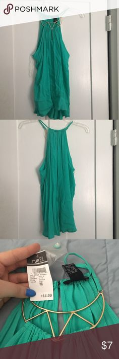 NWT teal going out top NWT rue21 teal going out top. Tank with a high neck and the neck piece is gold. Size medium. This tank is suppose to be flowy and not fitted. Rue21 Tops Tank Tops