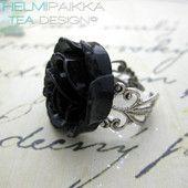 Musta-hopea ruususormus 10€