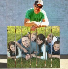 Get an 18x24 matte print of any picture from staples for $3. Modge podge print directly on wooden pallet with matte modge podge