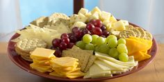 A party just wouldnt be a party without a beautifully arranged tray of cheese. Luckily, you dont have to be a chef to put one together. Purchasing sliced cheese in the Deli makes it super simple. Cheese And Cracker Platter, Cheese Platters, Food Platters, Cheese And Crackers, Simple Cheese Platter, Snacks Für Party, Appetizers For Party, Appetizer Recipes, Party Trays