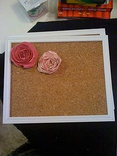 cork board in picture frame. paper roses on push pins