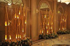 Bamboo stalks lit subtly from the inside adorns the entrance to this foyer.