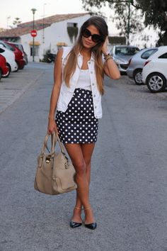 Polka dots are a timeless classic!  This girl wears them well! #prints