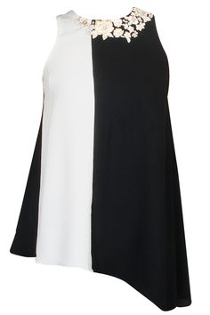 Black and cream vertical color blocked high low top available only at Pernia's Pop-Up Shop.