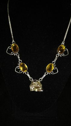 Bismuth and Citrine Necklace by KarinsForgottenTreas on Etsy