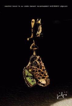 orecchino: bronzo - ferro - zoisite - ceramica - oro - diamanti