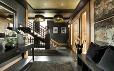 black and honey wood    Le Petit Palais is a luxury ski chalet located in Courchevel, in the French Alps.