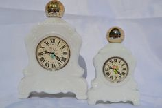 """Pair of Vintage AVON Milk Glass Clock """"Field Flowers"""" Perfume Bottles. These are two adorable milk glass bottles with a clock face. They are Avon's """"Field Flowers"""" perfume bottles."""