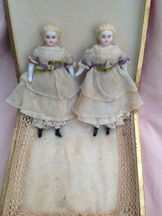 Lovely Pair Early Parians All original in Box - They come in this wonderful early French wooden box which is just gorgeous. A delightful pair, perfect for a larger dolls house or just for displaying in their box. 6""