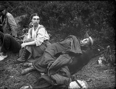 Two women hikers resting on a camping trip, 1907. Photograph by Asahel Curtis via the Washington Historical Society.