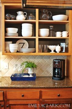 Create open shelving by removing cabinet doors and arranging dishes inside. If you want to make it look really intentional, paint the back of the cabinets. Here is the link for more info:  http://emilyaclark.blogspot.com/2012/08/open-shelving-in-our-kitchen.html