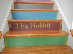 painting titles onto our storybook staircase