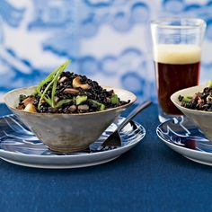 For a robust take on the Indonesian fried rice dish nasi goreng, Sang Yoon stir-fries black rice, sometimes called forbidden rice, with bacon and roasted g. Black Rice, Brown Rice, Food & Wine Magazine, Rice Dishes, Asian Recipes, Chinese Recipes, Fries, Healthy Eating, Healthy Food