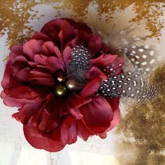 Oxblood burgundy flower clip with dotted feathers and pearls. Hair fashion accessory.. $18.00, via Etsy.
