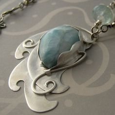 pendant... I bet I could make this from silver metal clay and a stone