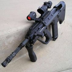 Steyr AUG with ACOG, off-set mini RDS optic, and vertical forehand grip