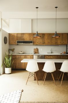 contemporary wood kitchen, white bar stools