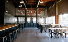 This renovated modern warehouse is a unique event, offsite and meeting space. Huge windows make it sunny, cozy and warm while  industrial elements, concrete floors and modern decor make it contemporary.