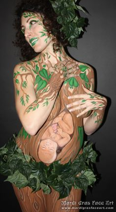One of my all time favourite belly paints by my friend Kim!    MARDI GRAS FACE ART!   Body Painting by KIM BRENNAN     (204) 955-2762     Model is Chelsey Goodman