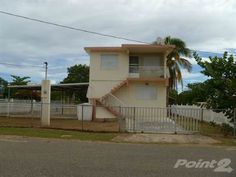 This is a perfect opportunity to own this multifamily investment property located within walking distance to Combate Beach. 2 levels, corner property, all concrete construction, ideal investment for