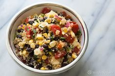 Quinoa Salad with Black Beans, Corn, and Tomatoes Recipe Salads with quinoa, salt, water, diced red onions, lime juice, black beans, frozen corn, fresh corn, tomatoes, queso fresco, jalapeno chilies, chopped cilantro, olive oil