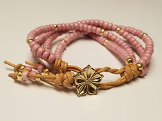 Excited to share the latest addition to my #etsy shop: Pink and Gold Beaded Bracelet/Leather Wrap Bracelet/Multi Strand Jewelry http://etsy.me/2zmwX4g