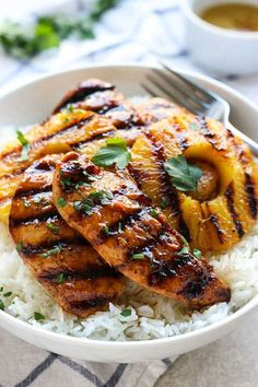Hawaiian Chicken with Coconut Rice - Easy and delicious tropical-inspired rice bowl dinner meal! Grilled or pan-fried chicken tenders marinated in soy and pineapple juice, combined with coconut rice and grilled fresh pineapple. Top Recipes, Dinner Recipes, Healthy Recipes, Cheap Recipes, Family Recipes, Fish Recipes, Recipies, Pan Fried Chicken Tenders, Coconut Chicken Tenders