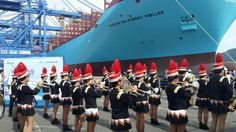 Marching band with the world's largest ship as the backdrop.